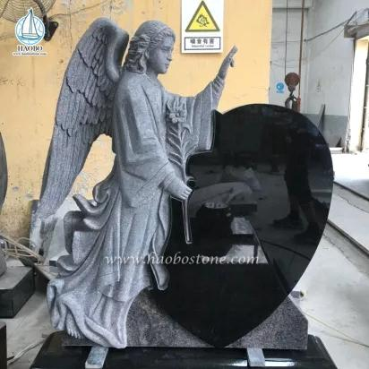 granite angel carved headstone